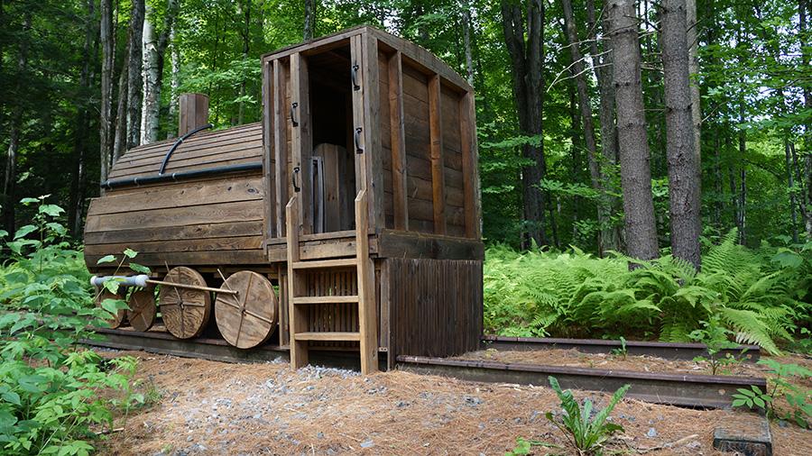 Locomotive Building Length: 10'; Width: 5' 8 1/4; Height: 7' 8 1/2 Hemlock wood and building materials.